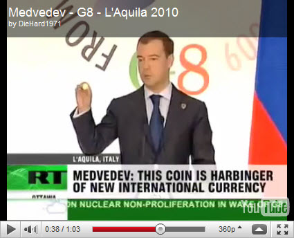 "Medvedev at G8 showing a ""Future World Currency"" coin"